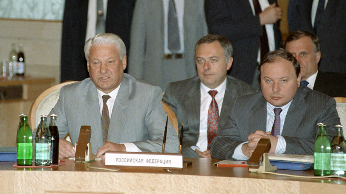 Russia's President Boris Yeltsin, seated left; Deputy Prime Minister Yegor Gaidar, seated 2nd right; Foreign Minister Andrei Kozyrev, seated 2nd left; and State Secretary Gennady Burbulis (RIA Novosti/Yuryi Abramochkin)