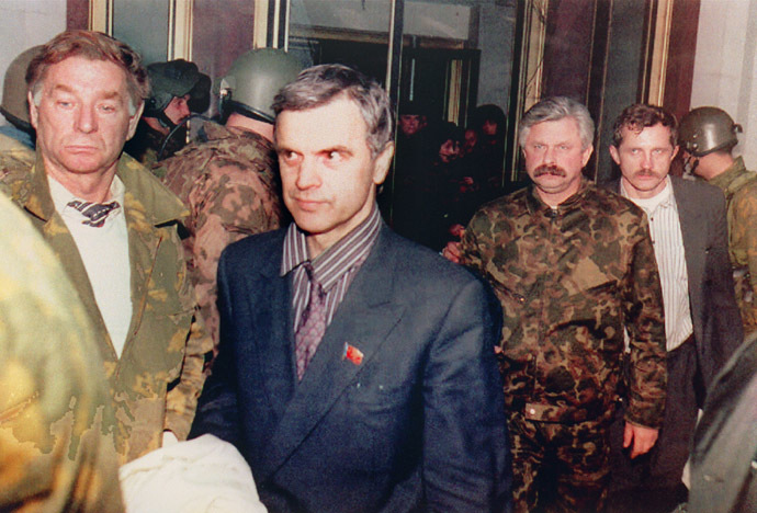 "Former Soviet Parliament Chairman Ruslan Khasbulatov (2nd-L) and former Parliament Vice-President Alexander Rutskoi (3rd-R) are guarded by members of ""Team Alpha"" special forces after being arrested 04 October 1993 inside of Parliament ""White House"" building during the coup d'etat as the anti-Yeltsin rebellion goes on. (AFP Photo/Dima Tanin)"