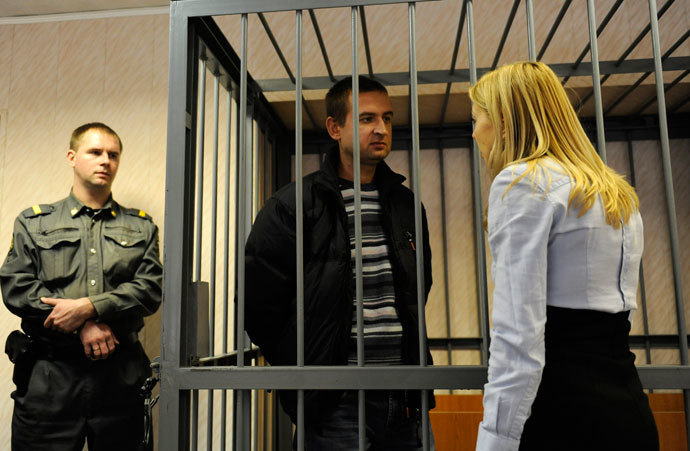 Ruslan Yakushev of Ukraine stands inside a defendants' box at a district court in Murmansk September 29, 2013.(Reuters / Sergei Eshchenko)