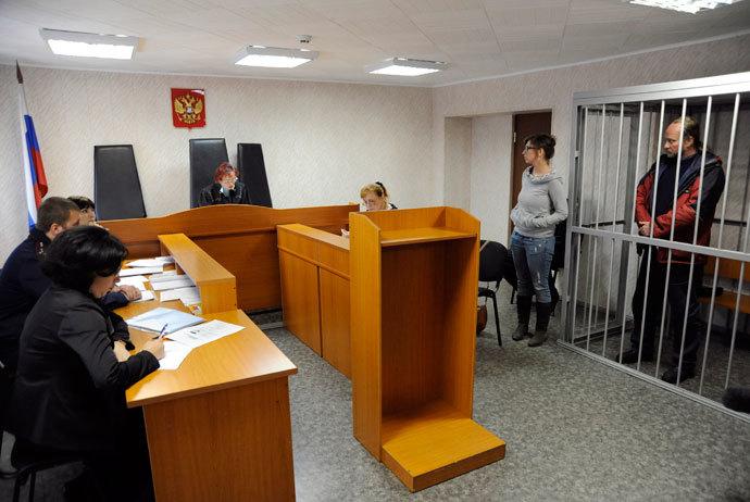 Greenpeace activist from Canada Paul Ruzycki stands inside a defendants' box at a district court building in Murmansk, September 26, 2013.(Reuters / Sergei Eshchenko)