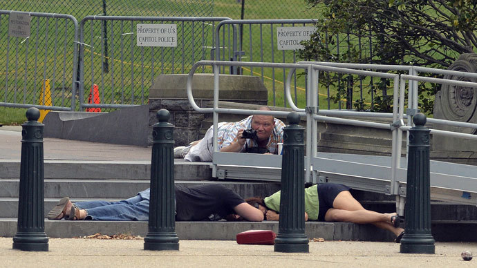 People take cover as gun shots were being heard at the US Capitol in Washington, DC, on October 3, 2013. (AFP Photo / Jewel Samad)