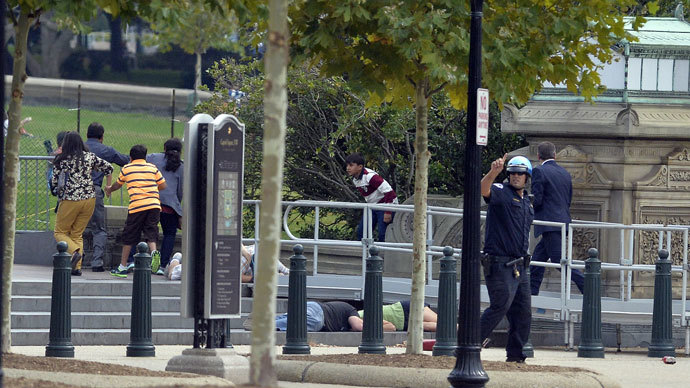 People take cover as gun shoot being heard at the Capitol in Washington, DC, on October 3, 2013.(AFP Photo / Jewel Samad)