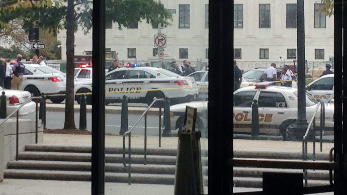 Law enforcement vehicles converge on the scene of a shooting on Constitution Avenue outside the Hart U.S. Senate Office Building as seen from inside the lobby of the building on Capitol Hill in Washington, October 3, 2013.(Reuters / David Lawder)
