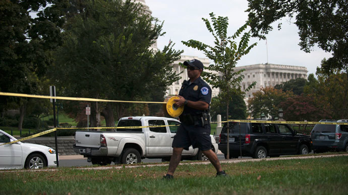 A U.S. Capitol Police officer secures the area with tape after shots were fired outside the U.S. Capitol building in Washington October 3, 2013. (Reuters / James Lawler Duggan)
