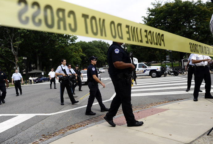 Police cordon off the US Capitol after shots fired were reported near 2nd Street NW and Constitution Avenue on Capitol Hill in Washington, DC, on October 3, 2013.(AFP Photo / Jewel Samad)