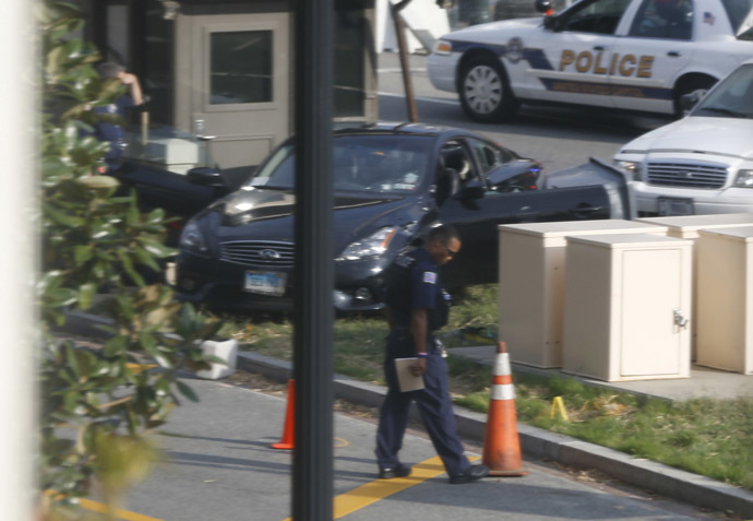 A black Infiniti coupe is pictured after its involvement in police shootout on Capitol Hill in Washington, October 3, 2013. (Reuters/Jason Reed)