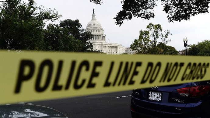 Police cordon off the US Capitol after shots fired were reported near 2nd Street NW and Constitution Avenue on Capitol Hill in Washington, DC, on October 3, 2013. (AFP Photo / Jewel Samad)