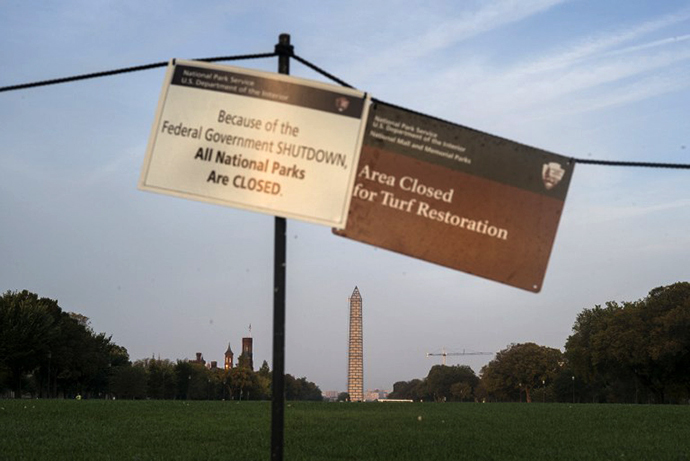Sings indicate that the National Mall is closed both for turf restoration and because of a government shutdown October 3, 2013 in Washington, DC. (AFP Photo / Brendan Smialowski)