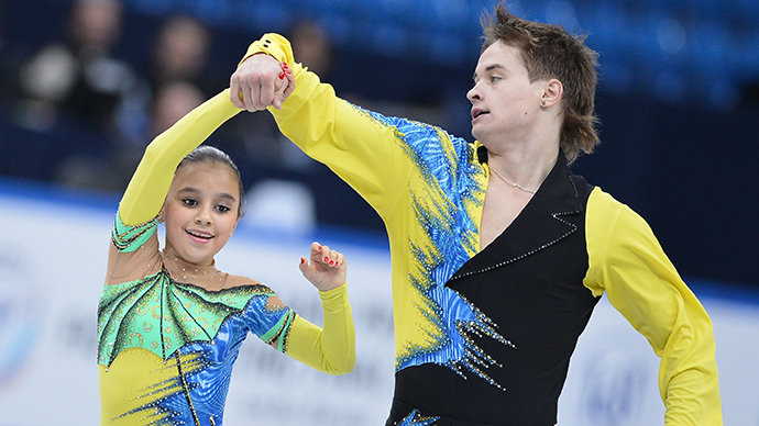 Lina Fyodorova and Maxim Miroshkin performing their pairs short program at the Junior Grand Prix of Figure Skating Final. Sochi, Russia. (RIA Novosti / Alexander Vilf)