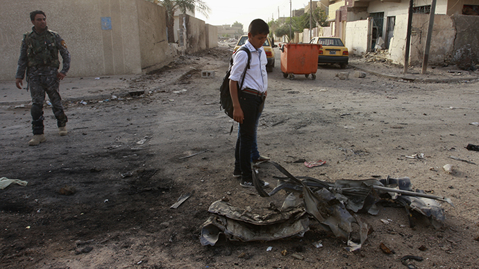 ARCHIVE PHOTO: A student stands at the site a day after a car bomb attack in Baghdad's  al-Maalef district, October 3, 2013. (Reuters / Ahmed Malik)