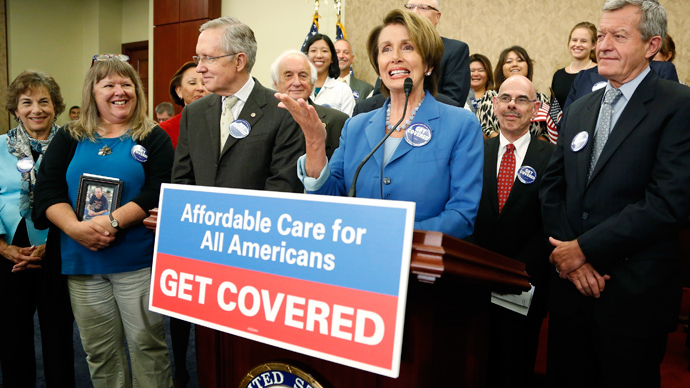 U.S. House Minority Leader Nancy Pelosi (3rd R) and Senate Democratic leader Harry Reid (3rd L) lead a rally to celebrate the start of the Affordable Care Act (commonly known as Obamacare) at the U.S. Capitol in Washington (Reuters / Jonathan Ernst)