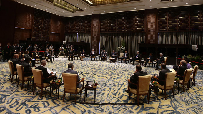 "This general view shows leaders gathered around during the ""Informal Conversation with Guests from Pacific Islands"" on the final day of the Asia-Pacific Economic Cooperation (APEC) Summit in Nusa Dua on the Indonesian resort island of Bali on October 8, 2013. (AFP Photo/Dennis M. Sabangan)"