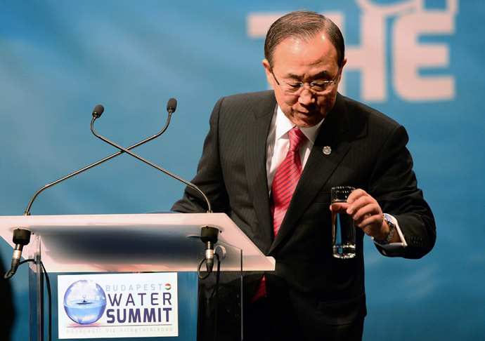 Secretary General of the United Nations Ban Ki-moon takes a glass of water as he makes his opening speech for 'Budapest Water Summit 2013' on the stage of the Millenaris Cultural Center in Budapest on October 8, 2013 during the beginning of the summit. Ban Ki-moon pays a visit to Hungary to open this world conference for clean water. (AFP Photo)