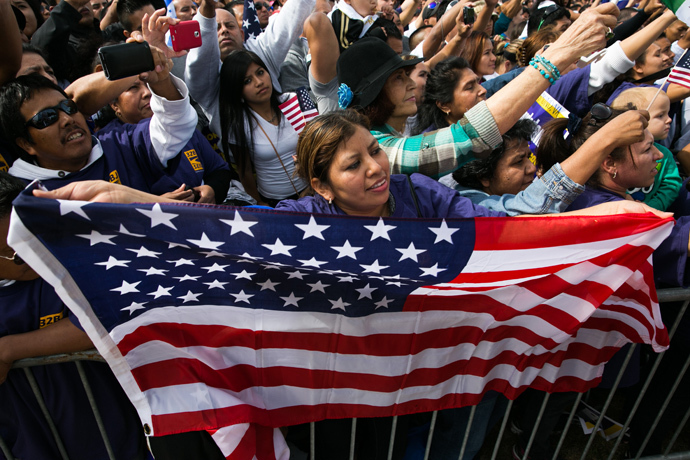 Lorena Ramirez, of Arlington, Virginia, holds up an American flag during a rally in support of immigration reform, in Washington, on October 8, 2013 in Washington, DC (Drew Angerer/ Getty Images / AFP)