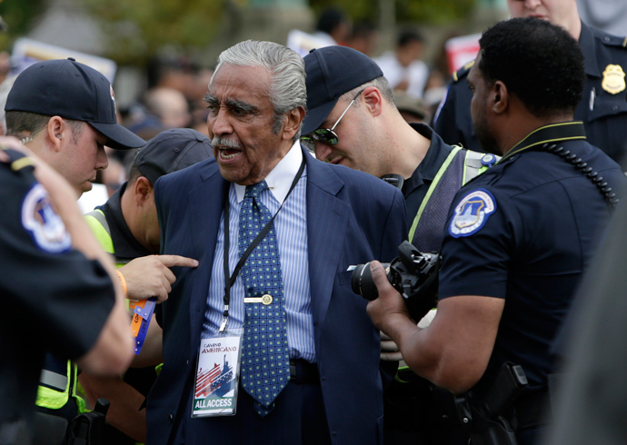 Representative Charles Rangel (D-NY) (C) is arrested by Capitol Hill police during a protest rally for immigrants rights on Capitol Hill in Washington October 8, 2013 (Reuters / Gary Cameron)