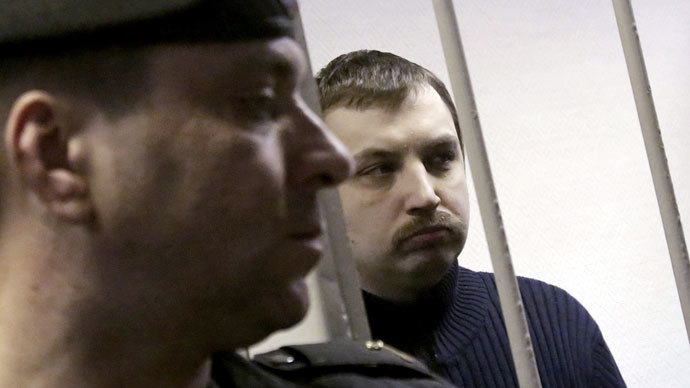 Mikhail Kosenko, charged with involvement in Moscow's Bolotnaya Square riots on May 6, 2012, is seen in the Zamoskvoretsky Courtroom while his sentence is being pronounced.(RIA Novosti / Alexsey Nichukchin)