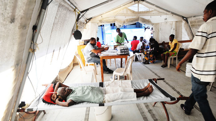 People lay in beds as Haitian health authorities deplored a resurgence of cholera on November 15, 2012 after Hurricane Sandy, according to MSF (medecins sans frontieres), with aid tents set up in Delmas, a suburb of Port-au-Prince.(AFP Photo / Thony Belizaire)