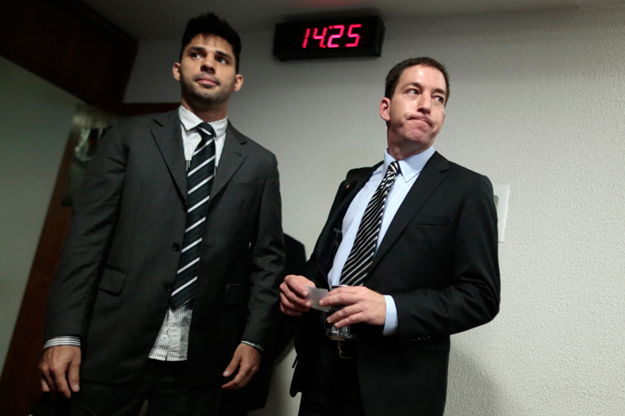 Glenn Greenwald (R), American journalist who first published the documents leaked by former NSA contractor Edward Snowden, arrives with partner David Miranda to testify in front of the Brazilian Federal Senate's Parliamentary Inquiry Committee, established to investigate allegations of spying by United States on Brazil, in Brasilia October 9, 2013 (Reuters / Ueslei Marcelino)