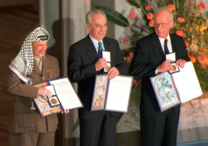 A picture dated 10 December 1994 of (from left) Palestinian leader Yasser Arafat, then Israeli Foreign Minister Shimon Peres, and late Israeli Prime Minister Yitzhak Rabin as they pose with the Nobel Peace Prize, which they were awarded in the Oslo City Hall (AFP Photo)