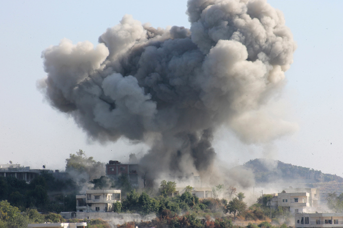 Smoke rises after what activists said was shelling by forces loyal to Syria's President Bashar al-Assad in the village of Dourit, in Latakia countryside August 17, 2013 (Reuters / Khattab Abdulaa)