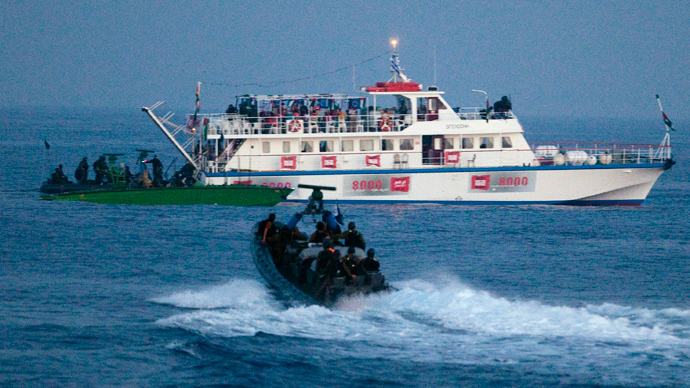 Israeli forces approach one of six ships bound for Gaza in the Mediterranean Sea (Reuters / Uriel Sinai / Pool)