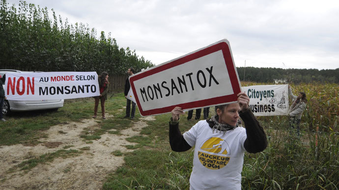 "Anti-GMO protestors demonstrate in front of US seed company Monsanto on October 12, 2013, in Monbequi, southern France. Banner reads: ""No to a world according to Monsanto"".(AFP Photo / Pascal Pavani)"
