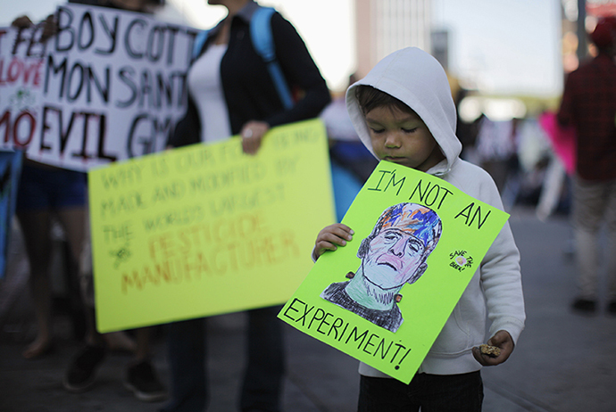 "Jameson Bluma, 3, holds a sign during one of many worldwide ""March Against Monsanto"" protests against Genetically Modified Organisms (GMOs) and agro-chemicals, in Los Angeles, California October 12, 2013. (Reuters / Lucy Nicholson)"