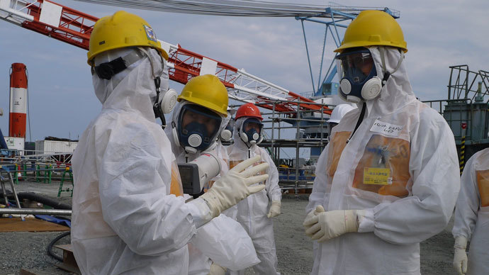 Luke Barret (R), external professional for TEPCO's contaminated water and tank countermeasures headquarters, inspecting TEPCO's Fukushima Dai-ichi nuclear power plant at Okuma town in Fukushima prefecture.(AFP Photo / TEPCO)