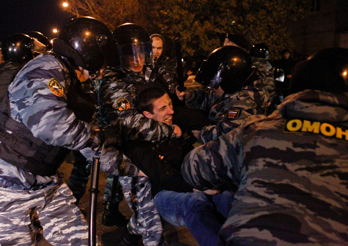 Russian police detain a man after a protest in the Biryulyovo district of Moscow October 13, 2013 (Reuters / Maxim Shemetov)