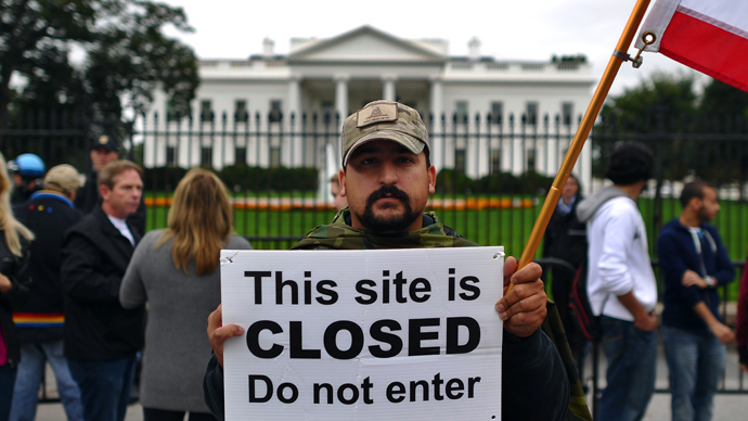 A protester holds a sign during a demonstration in front of the White House in Washington, DC, on October 13, 2013 demanding an end to the US federal government shutdown (AFP Photo / Jewel Samad)