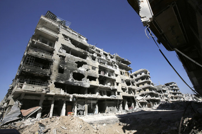 A picture taken on July 31, 2013 shows a devastated street in the Khalidiyah district of Syria's central city of Homs. (AFP Photo/Joseph Eid)