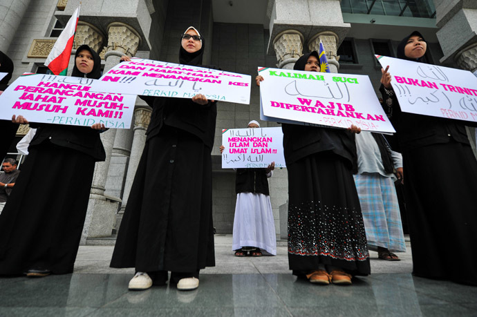 "Protestors display placards reading ""Allah word only can be used by Muslims"" during a demonstration at the court of appeal in Putrajaya, outside Kuala Lumpur on October 14, 2013. (AFP Photo/Mohd Rasfan)"