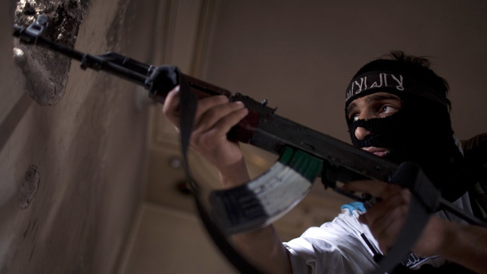 A Rebel fighter aims his weapon during fighting against Syrian government forces on September 19, 2013 in the Saif al-Dawla district of the northern Syrian city of Aleppo. (AFP Photo/JM Lopez)