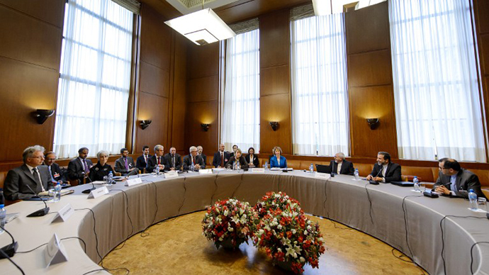 Iran's and world powers' delegations sit prior the start of two days of closed-door nuclear talks on October 15, 2013 at the United Nations offices in Geneva. (AFP Photo / Fabrice Coffrini)