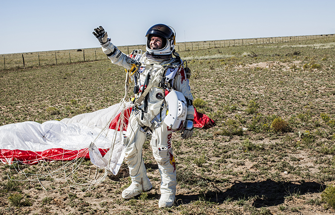 Pilot Felix Baumgartner of Austria celebrates after successfully completing the final manned flight for Red Bull Stratos in Roswell, New Mexico, USA on October 14, 2012. (Red Bull Stratos / Red Bull Content Pool)