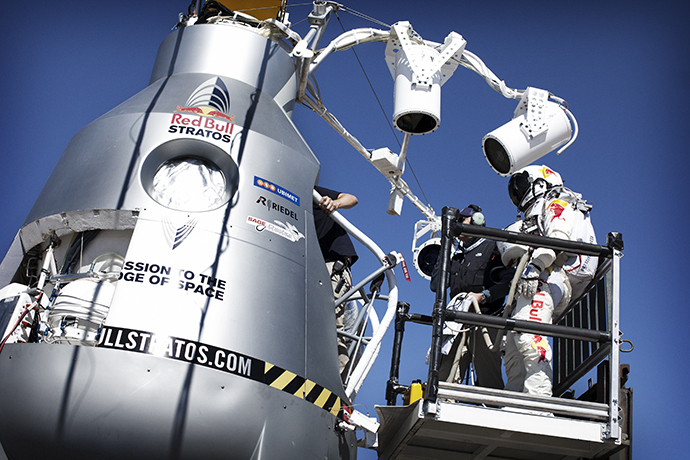 Pilot Felix Baumgartner of Austria stands on the forklift in front of the capsule during final manned flight for Red Bull Stratos in Roswell, New Mexico, USA on October 9, 2012. (Red Bull Stratos / Red Bull Content Pool)
