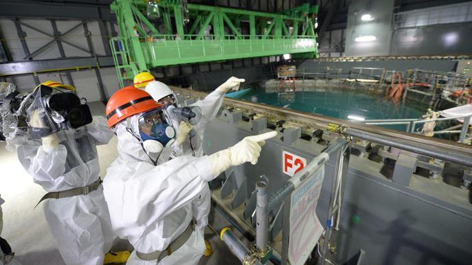 AFP Photo / Japan Pool via JIJI Press Japan out