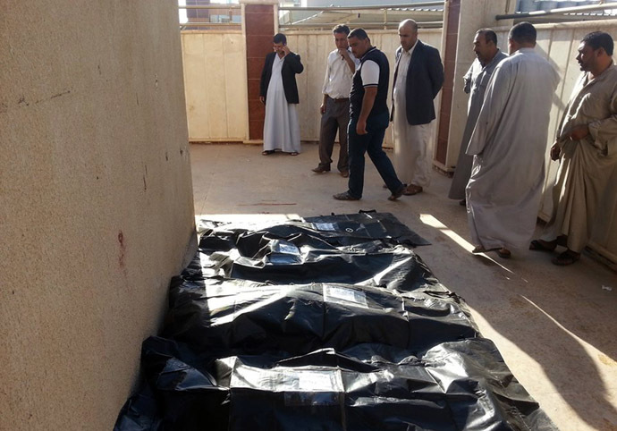 Bodies of victims killed in a suicide attack that tore through a residential area of Muwaffaqiyah, a village east of Mosul, are lined up for identification at a hospital in the northern Iraqi city on October 17, 2013. (AFP Photo)