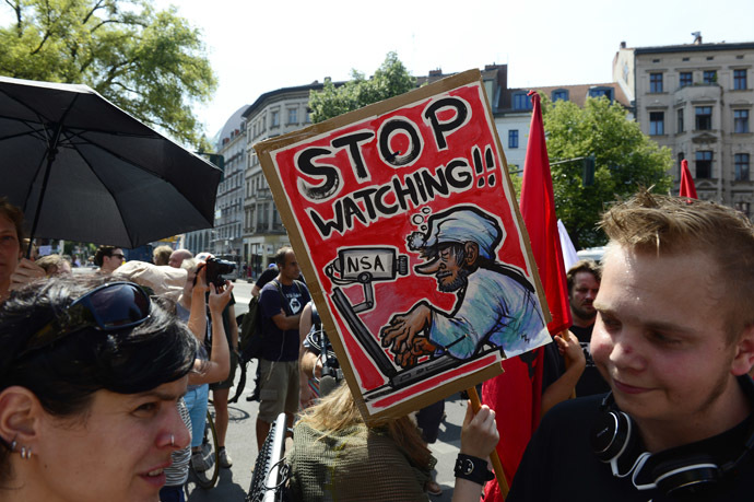 Demonstrators take part in a protest against the US National Security Agency (NSA) collecting German emails, online chats and phone calls and sharing some of it with the country's intelligence services in Berlin on July 27, 2013. (AFP Photo/John Macdougall)