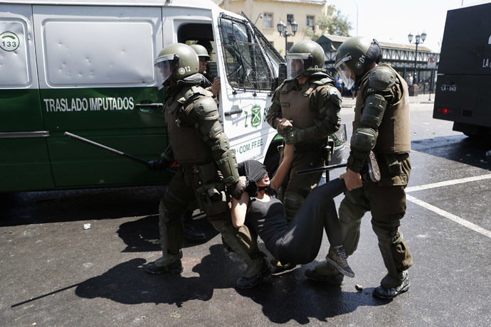 A student protester is detained by riot policemen during a demonstration against the government to demand changes in the public state education system in Santiago, October 17, 2013. (Reuters//Ivan Alvarado)