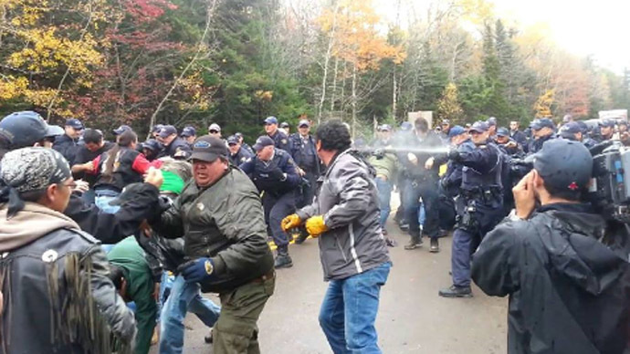 Police hosing fracking protesters in New Brunswick, Canada. (Photo fronm twitter/@MattThor)
