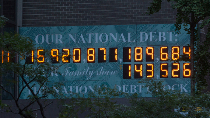 The national Debt Clock is seen in New York October 15, 2013 (Reuters / Andrew Kelly)