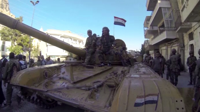 Syrian government's tanks on the streets of the mostly-Christian settlement of Maaloula. (Still from RT video)