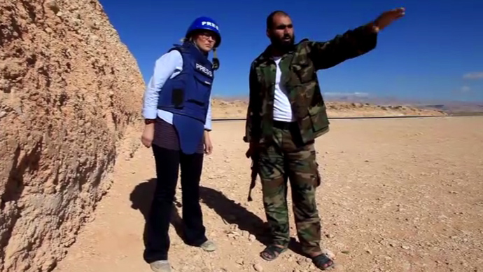 RT's Maria Finoshina (L) interviews Free Syrian Army Fighter, Abu al Hasan, outside the village of Maaloula. (Still from RT video)