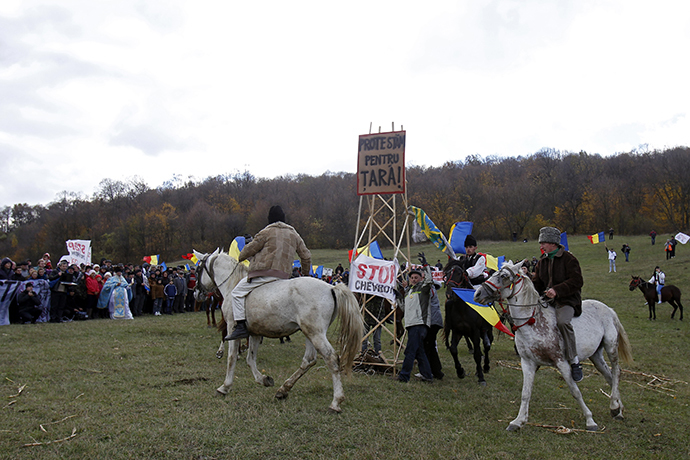 Men ride horses around a makeshift well during a protest against plans by U.S. oil major Chevron to search for shale gas in Pungesti, 340 km (211 miles) northeast of Bucharest October 19, 2013. (Reuters / Bogdan Cristel)