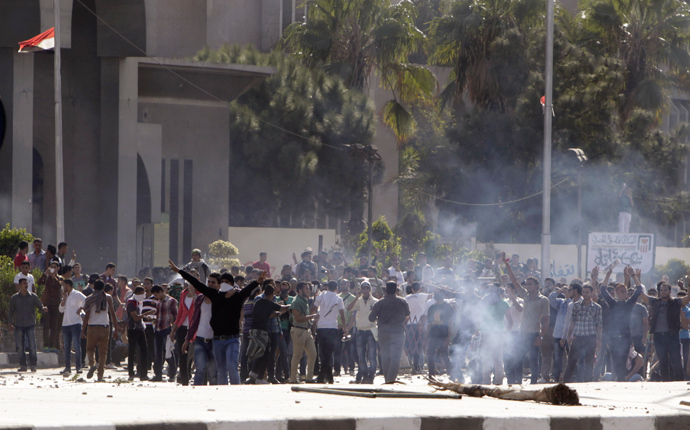 Protesters gather amidst remnants of teargas smoke during clashes with riot police at Al-Azhar University in Cairo October 20, 2013 (Reuters / Mohamed Abd El Ghany)