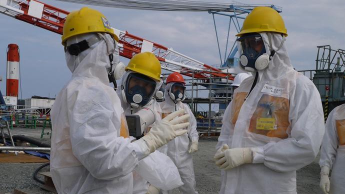 Heavy rains overflow barriers surrounding Fukushima water tanks