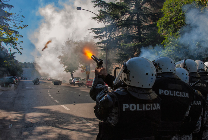 Police fire teargas at opponents of same-sex rights in Podgorica October 20, 2013 (Reuters / Stevo Vasiljevic)