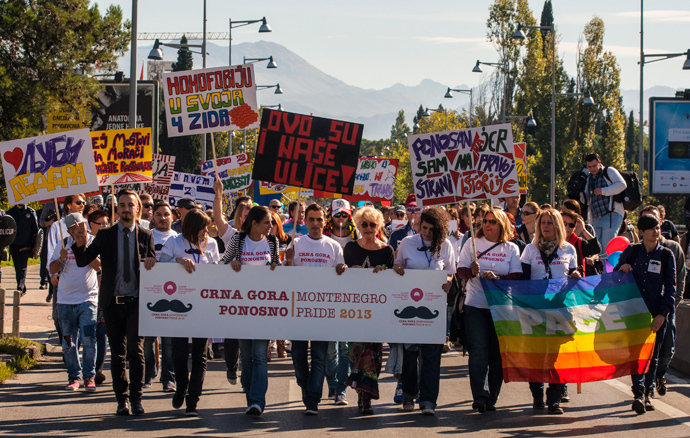 Gay-rights supporters, including a number of human rights activists, walk during the Pride March in Podgorica, October 20, 2013 (Reuters / Stevo Vasiljevic)