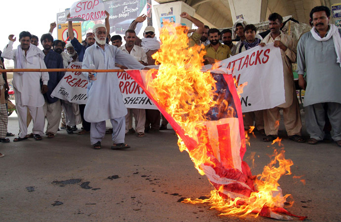 Pakistani protesters from the United Citizen Action torch a US flag against US drone attacks in the Pakistani tribal areas during a protest in Multan on July 14, 2013. (AFP Photo/S.S. Mirza)